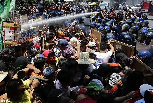 Stand off: Activists clashed with riot police in the Filipino capital, Manila, over a defence deal