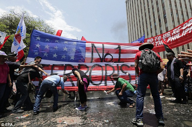 A flag with with 'No1 Terrorist' painted on was also set alight as activists shouted 'Nobama, no bases, no war'