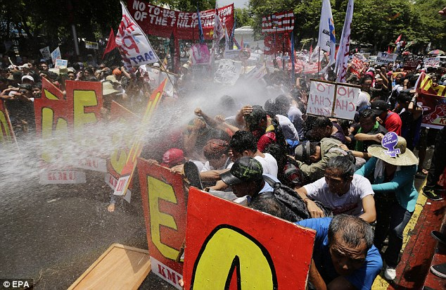 Push: Demonstrators holding placards and banners were held back by water cannons