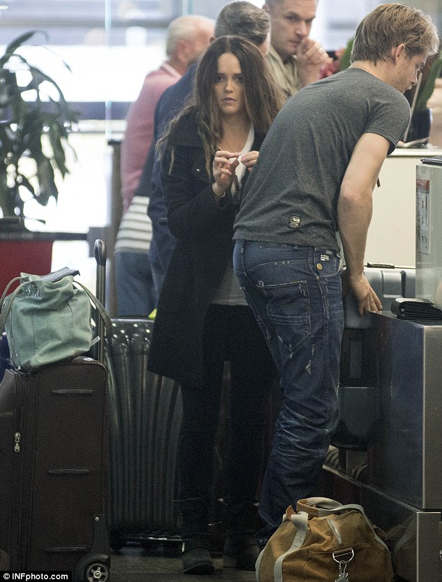 This is it! The couple check in at the airport as they prepare to jet out of Australia