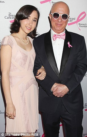 Making the effort: paul Scaffer wore a tuxedo, pale ink bow tie and pink ribbon as he arrived with his daughter, while Josh Grobin looked smart ion a black suit and tie