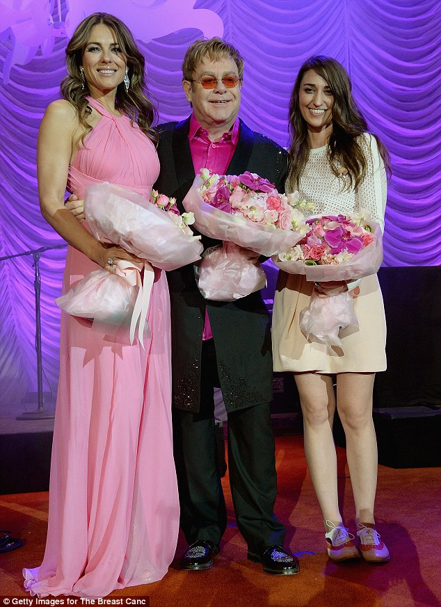Blooming lovely: Liz joined Elton John and Sara Bareilles onstage after performed for the charity event