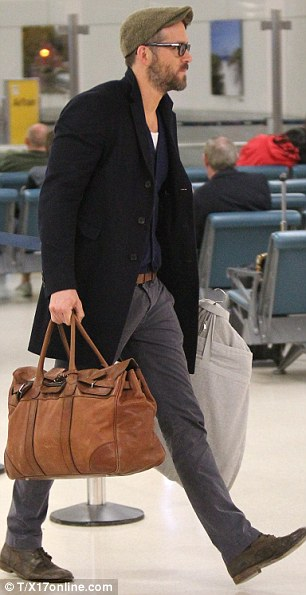 Missing him: Meanwhile Blake's husband Ryan Reynolds arrived from London back to NYC where he was  attending the screening of his new film The Voices
