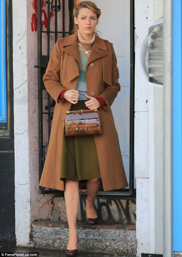 Shooting scenes: Blake looked cautious as she clutched hold of her character's brown bag