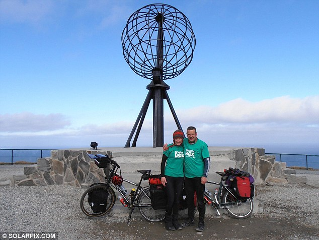 Adventurers: Mrs Bridgman wife her carpenter husband Tim in Nordkapp, Norway, on June 4, 2012, the first day of their rouind-the-world trip