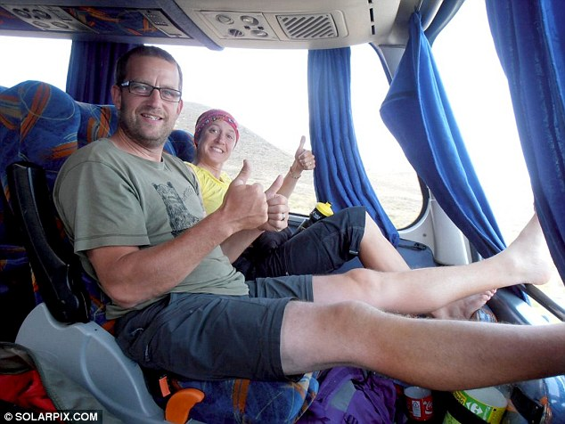 Thumbs up: Mr and Mrs Bridgman pictured in Argentina last year at the start of their 19,000 mile-leg of the trip from south America to north Alaska which they were part-way through when she died