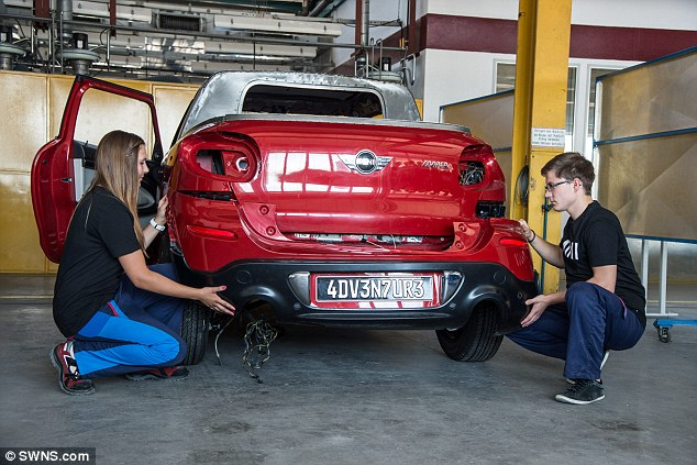 The Mini Cooper S Paceman was used as the base model for the pickup, with students, pictured, transforming the car into a two-seater with a pickup-style cargo area