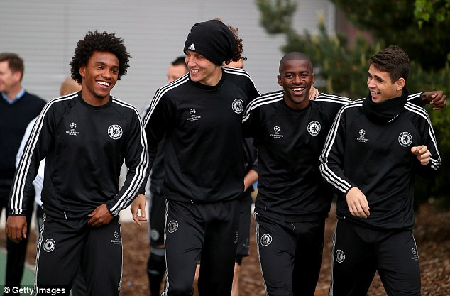 Relaxed and ready: Willian, David Luiz, Ramires and Oscar look in good spirits as they walk out for training