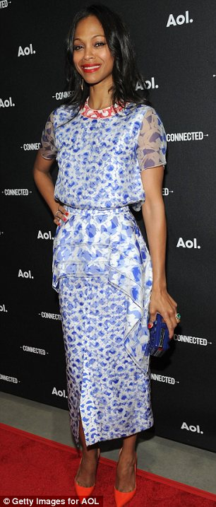 Fussy: Zoe Saldana brightened up her fussy dress with a  pair of bright orange shoes as she promoted her new show