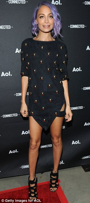 Centre of attention: Nicole Richie made sure she stood out at the AOL NewFronts in this dress which gave the impression of revealing her garters
