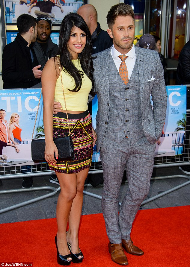 Comfortable: Ross put his arm round Jasmin's slender waist as they posed alongside each other