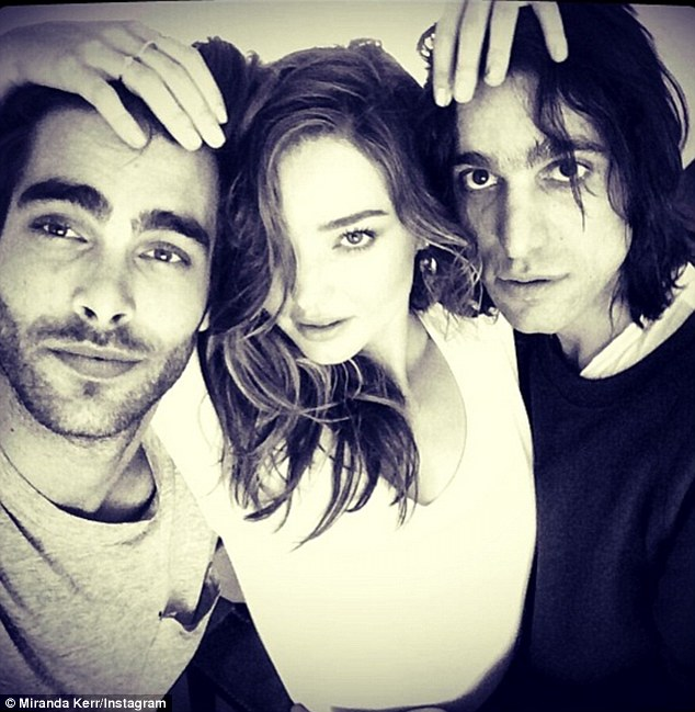 Model behaviour: On Monday, Kerr was busy on the set of another shoot with fellow model Jon Kortajarena, who was romantically linked to Madonna in the past, and photographer Sabastian Faena
