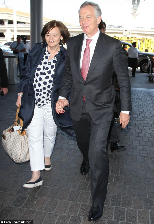 With wide smiles plastered across their faces as they held hands Tony Blair and his wife Cherie marched through LAX airport in Los Angeles last week