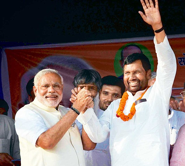 BJP's PM candidate Narendra Modi and LJP chief Ram Vilas Paswan at an election campaign rally in Hajipur