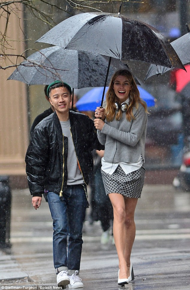 Sweater weather: Jessica Hart was seen happily strolling through the wet weather in Brooklyn, New York, during a fashion shoot on Wednesday