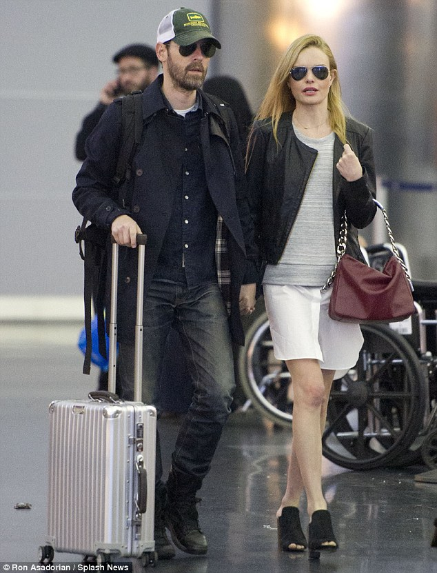 Suitcase for two: Kate and her husband Michael Polish were seen arriving in New York together on Wednesday