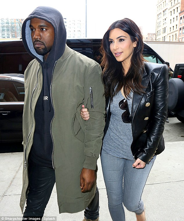 The bride and groom! Kim Kardashian and Kanye West have reportedly secured a 'confidential' marriage license and will marry in private, most likely at Kris's Calabasas home, in the coming week, ahead of their lavish French wedding and celebration next month