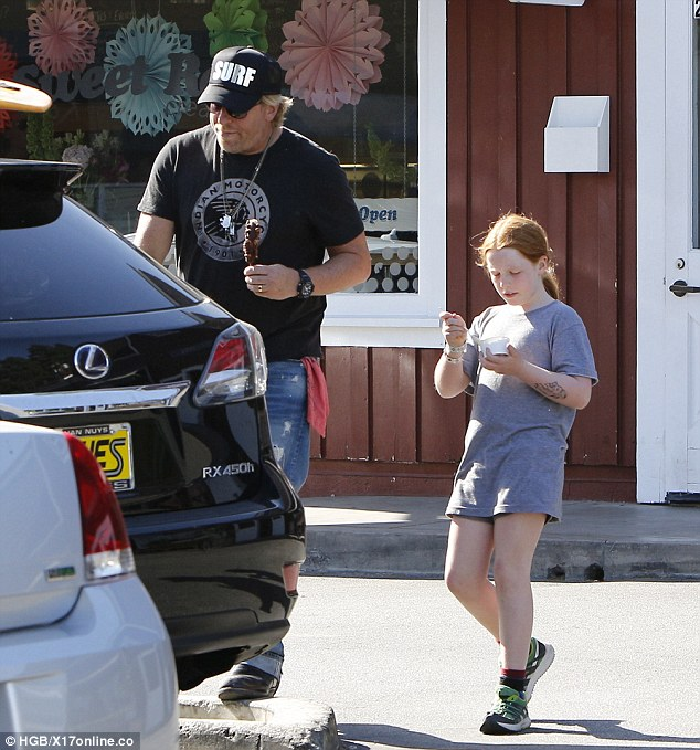 Yum! Makena Lei was seen eating her ice-cream while her dad led her to their car