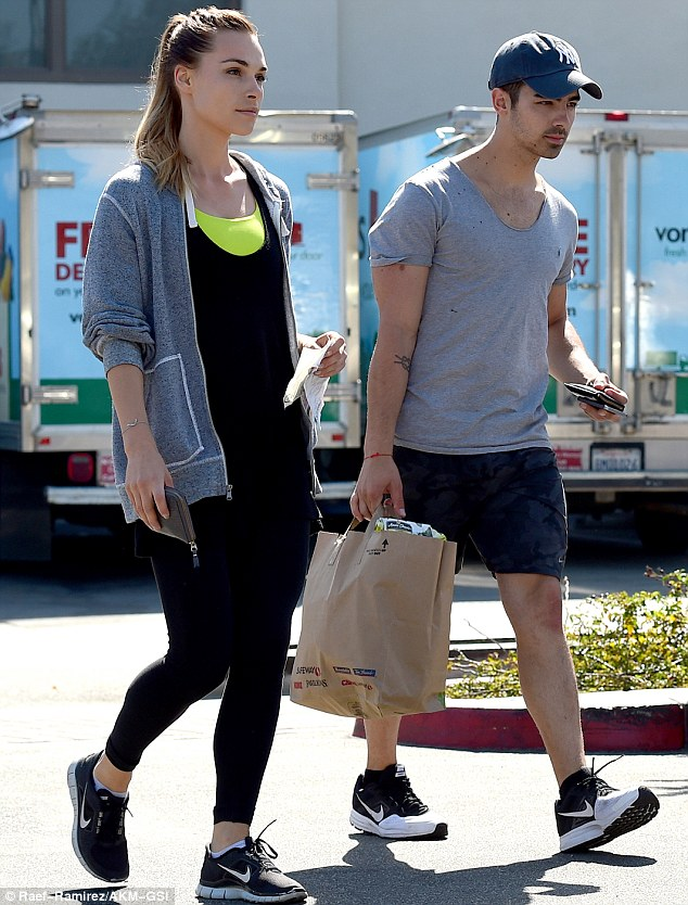 Top notch shopping: Joe and girlfriend Blanda Eggenschwiler stepped out for goodies at Pavilions in West Hollywood after their work-out