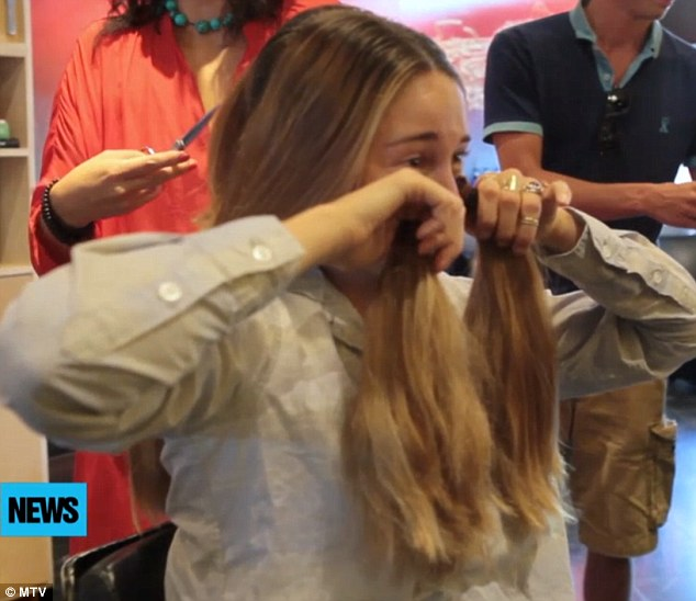 Wiping the tears away: Luckily for the starlet she discovered her old hair still had some uses after all