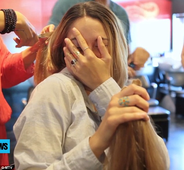 Head in her hands: She could not stand to look as her enthusiastic trim continued apace