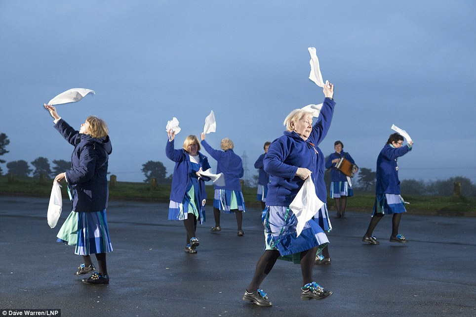 Hands in the air: To welcome the first day of May, the Glorishears dance at sunrise on Barr Beacon, near Birmingham