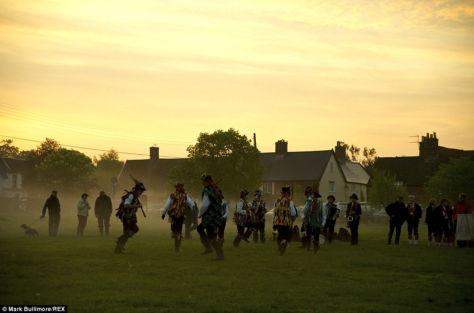 Stomping: Morris dancers are a stalwart of May Day celebrations. The performers in Norfolk are pictured here at dawn