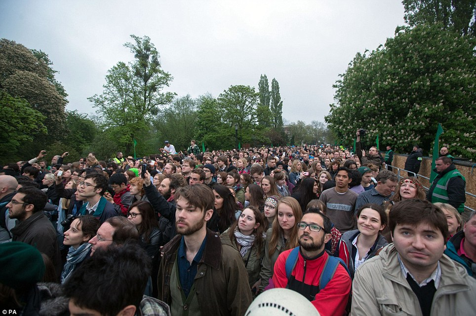 Huge crowds: People celebrate May Day morning on the bridge next to Magdalen College in Oxford