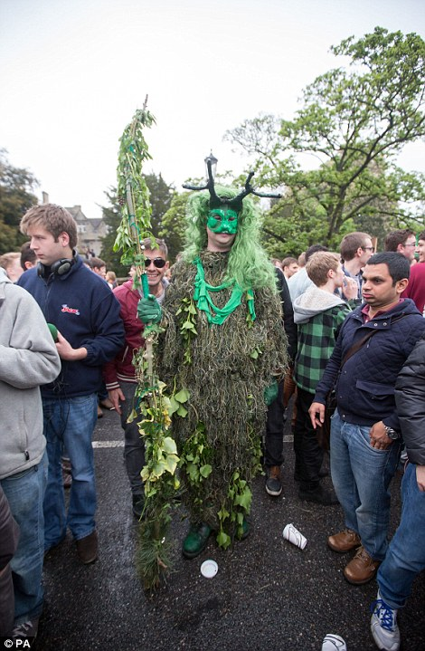 Fancy dress: Attendees in Oxford told how the rain stopped just before the choir kicked off the early morning celebrations by singing Hymnus Eucharisticus