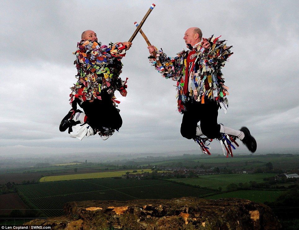 Up in the air: Wyvern Jubilee Morris dancers clash their sticks together while performing the traditional May Day dance on Ham Hill