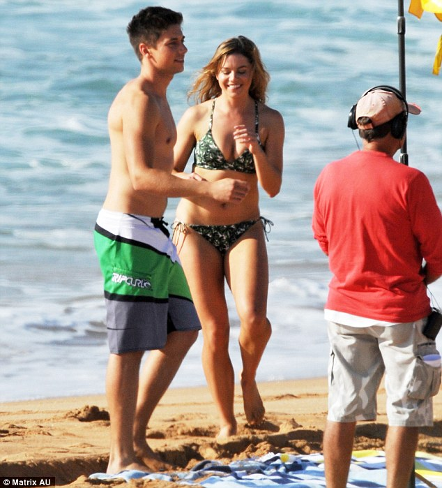 Beach bodies! The duo showed off their sculpted physiques in a skimpy bikini for Hannah and RipCurl board shorts for Lincoln