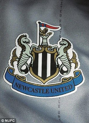 Detail: The pin stripe on the shirt reads out 'Newcastle United Football Club'