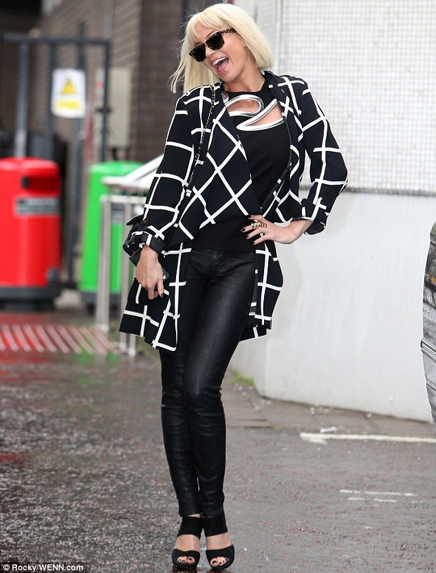 Posing up: Sarah looked in good spirits as she arrived at the studios