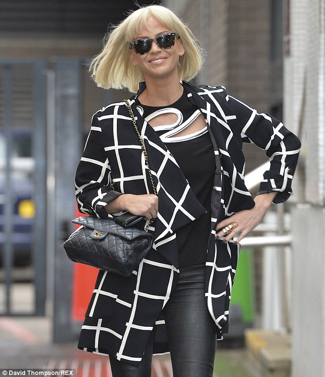 Check mate! Sarah stood out in an eye-catching coat as she arrived at ITV studios on Thursday