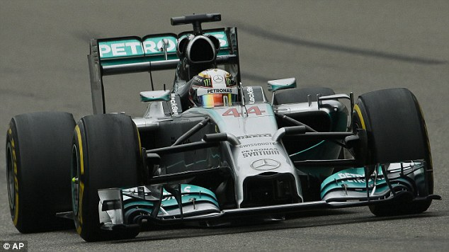 Right place right time: Hamilton (above) trails Mercedes team-mate Nico Rosberg by four points in the championship, with the German outfit having won the first four races