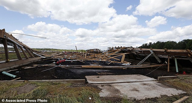 Splintered: Just lumber remains at the site of one of the chicken houses at nearby Hartness Farms