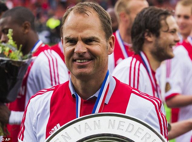 Winner: Frank de Boer celebrating his winning the Dutch league last Sunday