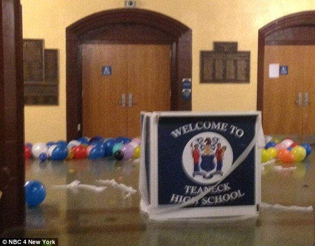 Dozens of students at Teaneck High School in New Jersey were arrested in the early hours of Thursday after an end-of-year prank got hand and led to the building being trashed