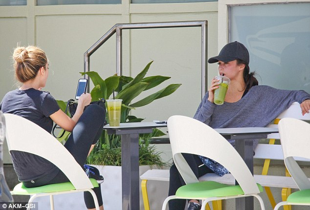 Keeping up the regime: The girls then headed to Lemonade Cafe for a spot of rehydration, and were spotted sipping on nutrient-packed green juices as they based in the sunshine