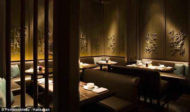 Dining: Prince Harry and pals dined at trendy Miami beach restaurant Hakkasan on Wednesday night, where he was seen chatting to a pretty brunette