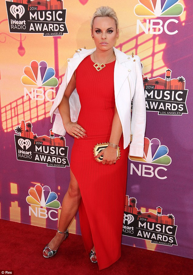 Ready to rock! Newcomer Katy Tiz made sure she stood out from the crowd in her bright red ribbed cotton dress featuring a thigh-high slit, which she paired with a gold spiked white leather jacket shrugged over her shoulders and patterned strappy peep-toe stilettos