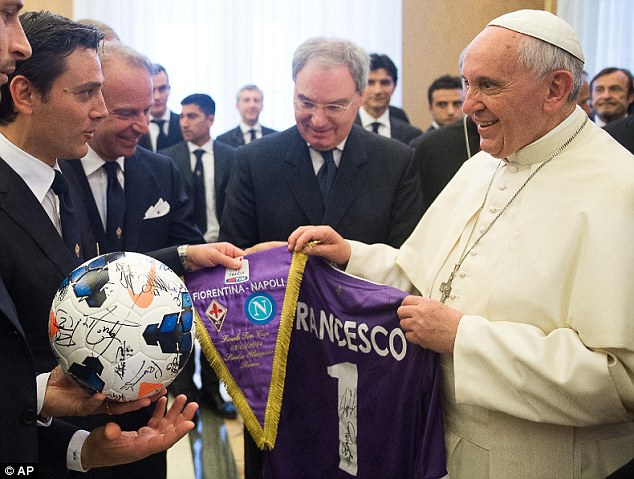 Generous: Pope Francis receives a ball, shirt and pennant from Fiorentina coach Vincenzo Montella