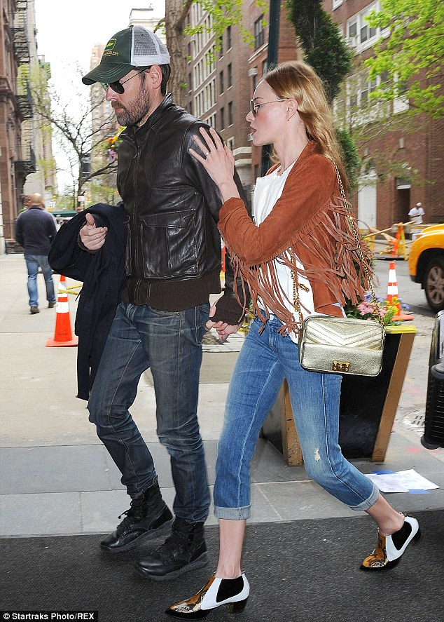 Hippie Hippie Shake: The 31-year-old actress wore a brown fringe jacket and snakeskin booties with her cuffed blue jeans