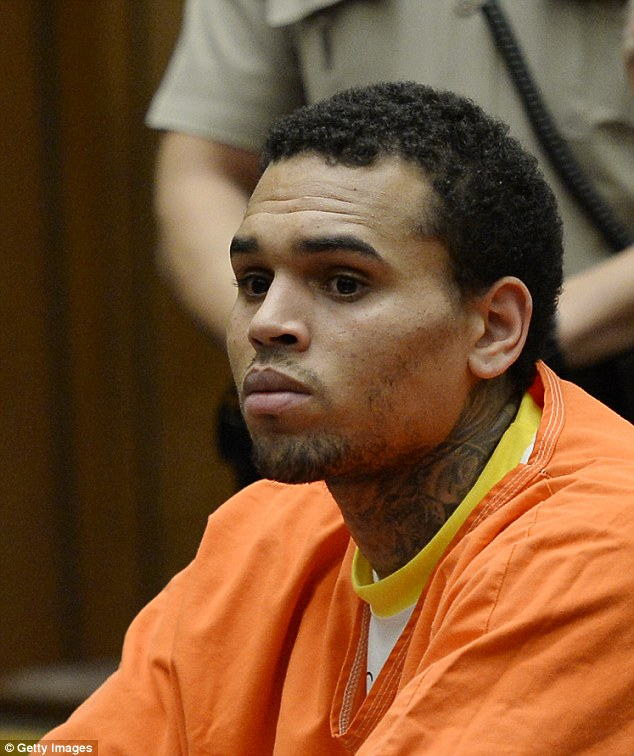 Haggard and dishevelled: R&B singer Chris Brown looked worn down after six weeks in jail as he appeared in Los Angeles Superior Court for a probation violation hearing on Thursday