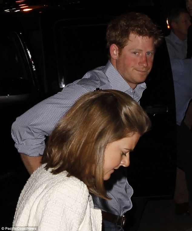 Shirt sleeves: The prince dressed down for the dinner in a blue and white checkered shirt