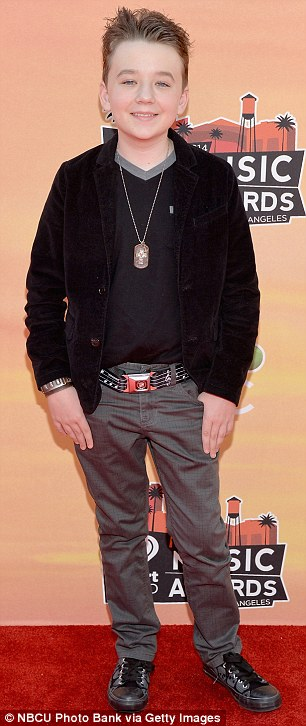 Pint-sized partiers: Modern Family's Nolan Gould (left) made quite the impression in his orange pants and '50s pin-up-style patterned shirt, while About A Boy star Benjamin Stockham opted for cool black and grey attire that revealed his edgier rocker style