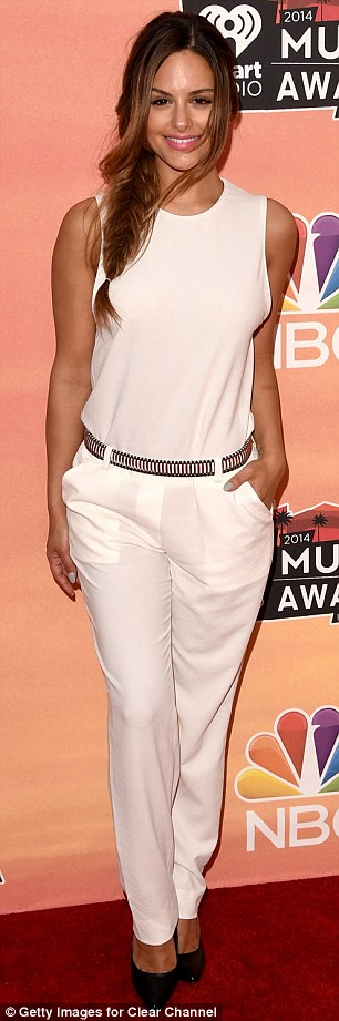 The cheek! Singer Pia Toscano twirled around to let the cameras capture all angles of her white semi-sheer jumpsuit, which she jazzed up with a metallic belt and black stilettos, while she wore her long blonde locks in a stylish fishtail braid and donned fresh, natural make-up