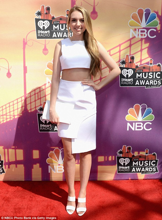Natural beauty: Olivia Somerlyn was the epitome of summer in her all-white outfit consisting of asymmetric high-waisted skirt, cropped top, strappy heels and clutch, which she teamed with her long golden mane style in soft waves over one shoulder and bare minimal make-up