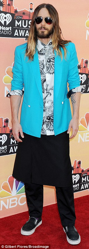 Too cool for school! Jared Leto brought his own unique flair for fashion to the event as always, rocking a black and white patterned shirt under a bright turquoise blazer, which was rolled up, along with black pants and a matching knee-length wrap skirt, completing his look with black sneakers and aviators