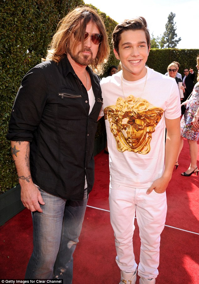 Everybody loves Billy Ray! Miley Cyrus's dad proved to be the big hit of the night, cosying up to all the top stars - including Austin Mahone